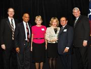 St. David's Round Rock Medical Center recently received the Business of the Year award from the Round Rock Chamber of Commerce. CEO Deborah Ryle (holding award) accepted the honor from Chamber leaders at the annual banquet.