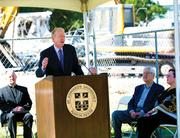 Philanthropist and Austin businessman Bill Munday and his wife, Pat, listen to St. Edward's University President George Martin during the ceremonial groundbreaking of the Munday Library.