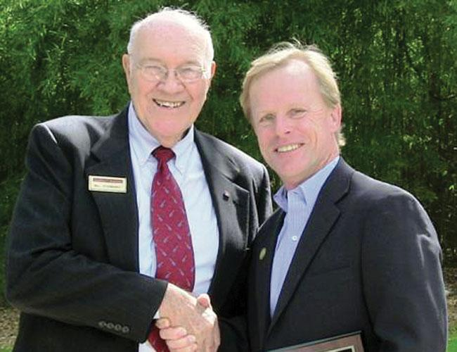 During Stanberry & Associates' 30-year anniversary celebration, Bill Stanberry (left) presented commercial broker Scott Daves with three awards: sales agent of the year, leasing agent of the year and the President's Club award.
