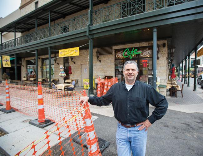 George Dreyfus, owner of Le Cafe Crepe, is glad to see the construction in front of his restaurant wrapping up.