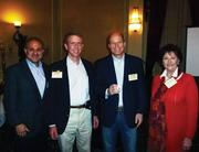 At the Technology Advisors Group's October meeting are (from left) Denary Consulting Partner Juan Cabezas, Jerel Walters, Mike Beltzer of Lithium Technologies and Deborah Leverett with Entera Partners.