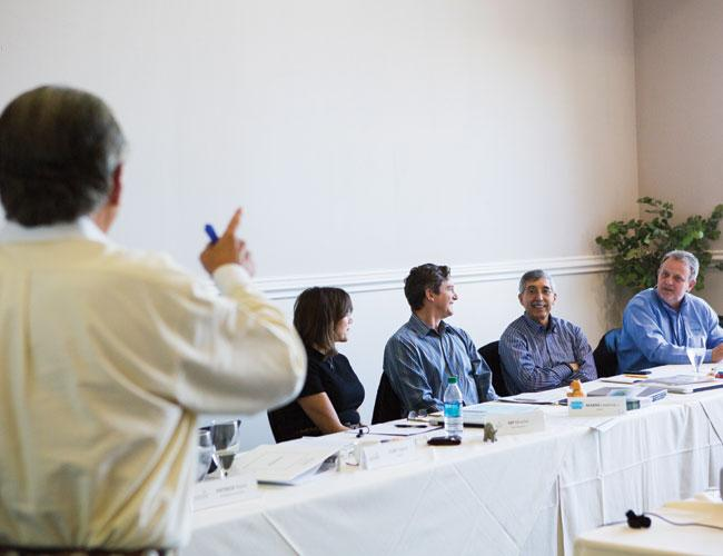 Seated from left, M.P. Mueller, Marsh Lavenue, Keith Shuley and Ed Trevis talk about their issues running businesses during a recent Vistage International advisory board meeting.