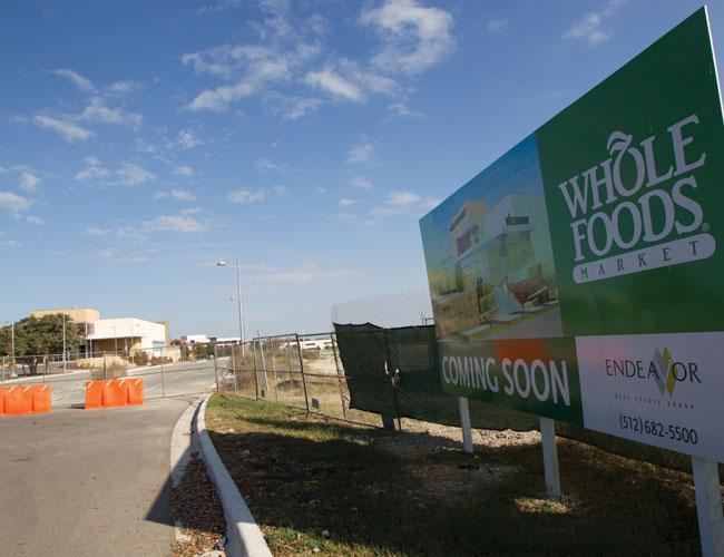 Whole Foods Market Inc.'s planned store at The Domain won't open until fall next year.