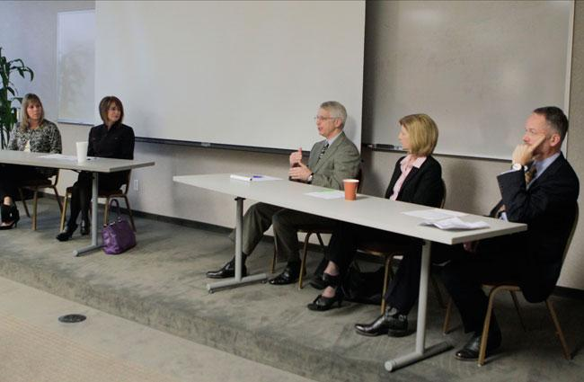 Dr. Gary Goldstein addresses his fellow panelists, from left, Chris LaMour, Christie Garbe, Patti Parker and Dr. Robert Watson.