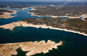 A drought-stricken Lake Travis in October 2011. The drought hit the lake and area businesses hard last year.