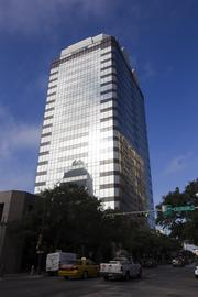 Also known as the JP Morgan Chase tower, 211 W. Sixth St. is appraised at $86 million. The 389,503-square-foot building  is owned by Spire Realty Group. The building was owned by Grubb & Ellis Realty Investors LLC until 2009 when Spire Realty Group bought the building for an undisclosed amount. At the time, the building was valued at $71.2 million by Travis County.  The 22-story building was designed by Lloyd, Morgan and Jones and completed in 1974. A 1994 renovation by Starnet International Corp. changed the building's glass from gold to blue and added a frame to the top, increasing the height by 10 feet. Drivers had complained about the sun's reflection off of the golden glass. The building was the highest in Austin from 1974 to 1975.