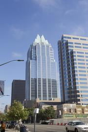 The Frost Bank tower, at 401 Congress Ave., is the most valuable and largest property downtown, according to Travis County records. At 33 floors, it's the third-tallest building in Austin. The building's geometric crown and central position on Congress Avenue have made it one of the city's best known buildings and a centerpiece of the skyline.  The building was delivered in 2003 - with a $137 million value - and originally owned by Atlanta-based developer Cousins Properties Inc. (NYSE: CUZ). In 2006 Cousins sold the tower to Equity Office Properties for $188 million. From there, a venture between Lehman Brothers Holdings Inc., California's Thomas Property Group Inc. (Nasdaq: TPGI) and a sovereign wealth fund in Abu Dhabi bought the tower as part of an eight-building portfolio in Austin for which they paid $1.2 billion. After Lehman Brothers declared bankruptcy, Thomas Property Group and the California State Teachers' Retirement System bought the portfolio of properties for a discounted $859 million.  The tower was designed by designed by HKS and Duda/Paine Architects LLP, and the main contractor on the project was Constructors & Associates Inc.  Current Travis County records value the 546,000-square-foot building at $172 million, more than $30 million more than the next most valuable building in the area.