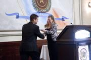 Austin Business Journal Publisher Heather Ladage gives awards to those being recognized.