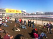 Fans on the inside of the track get a front-row seat for the action - though they have to make their own seat.