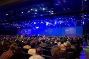 Attendees settle in before CEO Michael Dell and former President Bill Clinton speak. About 6,200 people registered to attend the conference.