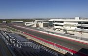 The view from outside Suite 1 looking towards turn 20 and the finish line. To the right is the pit paddock building and the media and conference center is on the left.