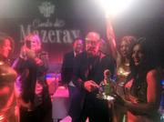 Bathed in the glow of red lights and sparklers, Austinite John Paul Dejoria - co-founder of Paul Mitchell Systems and Patron Spirits - parties at Ballet Austin downtown, which was turned into a party spot by My Yacht Group.