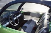 A look inside the green two-seater car, which operates with two single-drive motors - one for each drive wheel.