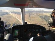 ABJ reporter Vicky Garza flew in one of Charlie Bravo's helicopters along State Highway 130 to get to the track.