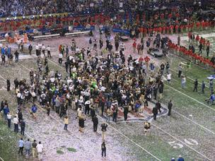 The Ravens celebrate on the field of the Superdome after defeating the San Francisco 49ers in Super Bowl XLVII.