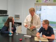 A science class at St. James Academy. This school teaches students from kindergarten through the 8th grade.