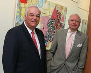 Dennis J. Shaughnessy (right, age 64), chairman of FTI Consulting Inc., is No. 8 on the List with $7.46 million in compensation. Here he is pictured with Jack B. Dunn IV (left), the company's president and CEO.