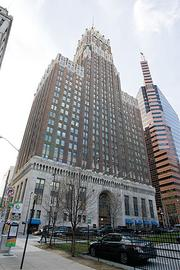 The new owners of the 10 Light St. office tower downtown plan to convert the building into 445 apartments.