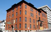 Washington, D.C.-based Broadwater Capital has acquired 300 Cathedral St., a former office  building known as Odd Fellows Hall. The firm plans to redevelop it into  59 one-bedroom and studio apartments by summer 2013.