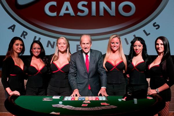 David Cordish, owner of Maryland Live, on Wednesday flanked by cocktail waitresses from the casino.