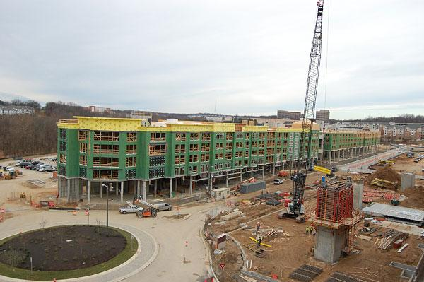 David S. Brown Enterprises Ltd. has finished installing beams on the first of two five-story apartment buildings under construction as part of the $550 million Metro Centre project.
