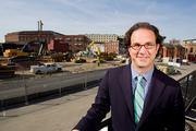 Toby Bozzuto, of Bozzuto Development, stands at the site of Fells Point's Union Wharf. The project, to be completed in fall 2013, will include 281 residential units.