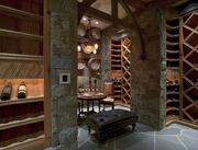 The 10-year-old French-style property of Martin and Georgie Fisher, built with imported stone and wood, includes a wine cellar.