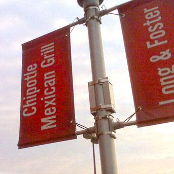 A banner for Chipotle hangs on a post outside the Can Company in Canton.