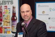 John Dinkel, president and publisher of the Baltimore Business Journal, addresses guests at a VIP reception.