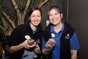 Stephanie Harpt, left, of the National Aquarium holds a Shingleback Skink lizard named Roofus. Liz Evans with Lucky, a Bearded Dragon lizard.