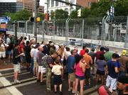 Grand Prix spectators lined the course on Pratt Street to catch a glimpse of cars speeding by.