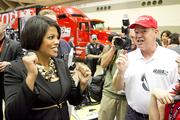 Mayor Stephanie Rawlings-Blake and two-time Indy 500 winner Al Unser Jr. inside the Baltimore Convention Center paddock area on Friday.