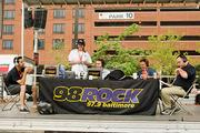 """98 Rock's """"Bacon and Bud"""" morning show broadcast live the old McCormick Spice lot at Conway and Charles Streets."""