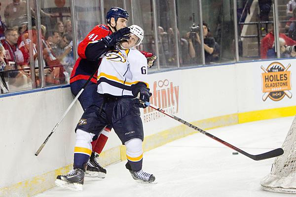 Washington Capitals defenseman Patrick Weller, red, gets into a collision with a Nashville Predator in the third period of the Baltimore Hockey Classic.