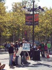 Just before the finish line at Camden Yards, a fan holds a sign notifying runners that 'Beer awaits.'