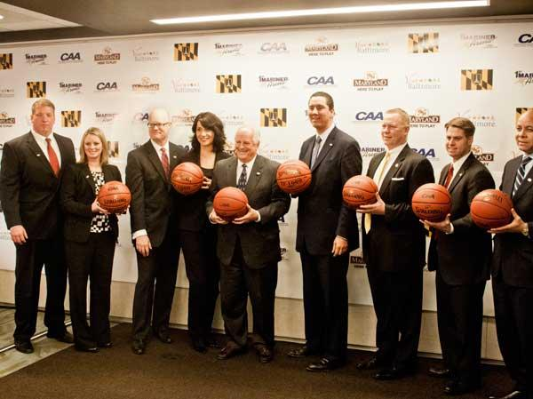 CAA Commissioner Tom Yeager, fifth from left, joins city and state officials on Wednesday to announce the conference's men's basketball tournament will come to Baltimore starting in 2014.