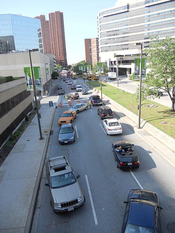 A one-way route along Charles Street turns into traffic going in both directions on Tuesday morning as construction begins along the busy commuter thoroughfare.
