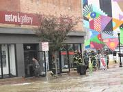 The Metro Gallery in Station North was impacted by a water main break along Charles Street on Wednesday.