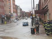A water main break along Charles Street in Station North impacted business on Wednesday.