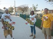 Supporters of Jason Kahler, a candidate for the Baltimore City Council District 1 seat, hold signs on Tuesday morning in East Baltimore.