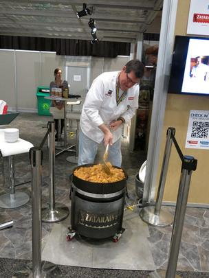 Dudley Passman of Zatarain's stirs 40 gallons of seafood jambalaya for members of the media during Super Bowl week.