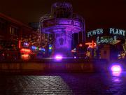 The fountain outside Power Plant Live glows purple.
