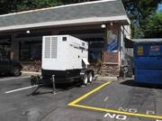An electrical generator parked in front of S'ghetti Eddie's in Roland Park.