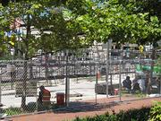 Construction crews take a break Tuesday while assembling grandstands for the Baltimore Grand Prix.