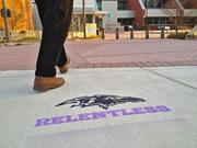 The Ravens logo and the mantra 'Relentless' has been stenciled on sidewalks at over 500 locations throughout the Baltimore area. This one is located in front of Howard County Government's Headquarters in Ellicott City.