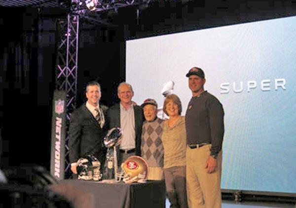John Harbaugh, left, and Jim Harbaugh, far right, pose with their parents and grandfather after Friday's press conference in New Orleans.