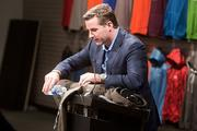 Under Armour CEO Kevin Plank pours water on its new Storm Cotton sweatshirt to show how moisture does not absorb into the product.