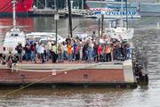 Members of the media gather on a pier at the Inner Harbor as Nik Wallenda prepares to cross the Inner Harbor on a tightrope.
