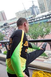 World renowned tightrope walk Nik Wallenda stretches before crossing the Inner Harbor on Wednesday.