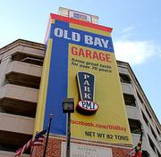 A five-story Old Bay can on a garage off President and Pratt streets. The parking structure has been renamed the Old Bay Garage.